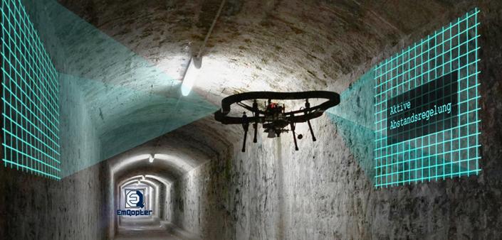 drohne fliegt im tunnel mit emqopter logo
