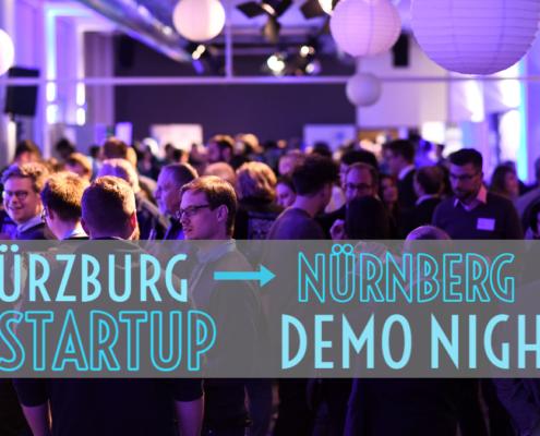 menschen in lila licht getaucht bei der startup demo night in nürnberg