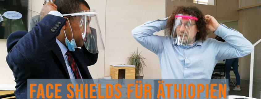 zwei Mäner mit Face Shields, äthiopischer Konsul
